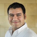 Head shot photograph of Victor Cruz