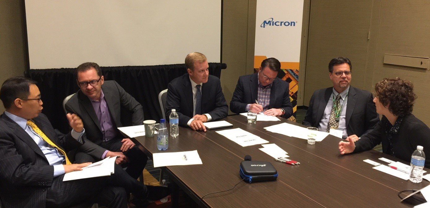 Micron's smart manufacturing panel members meeting in a conference room