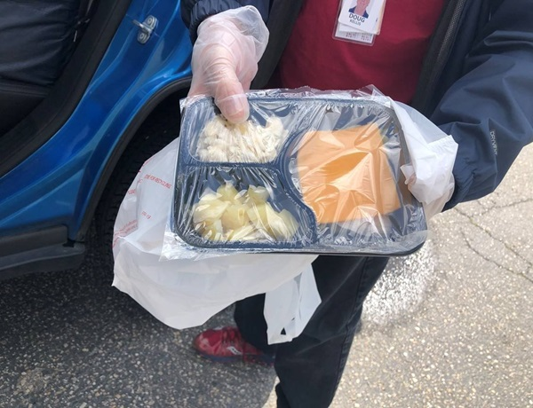 Doug Kellis displays one of the prepared lunches