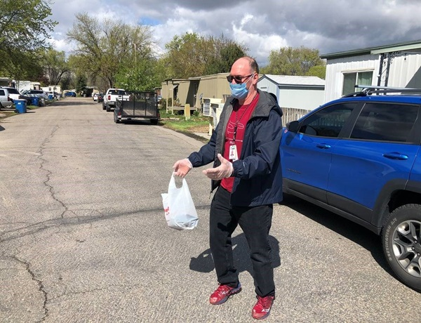 Doug Kellis jumps in his blue Jeep and delivers prepared lunches
