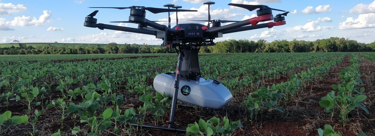 A drone hovering over an agricultural field