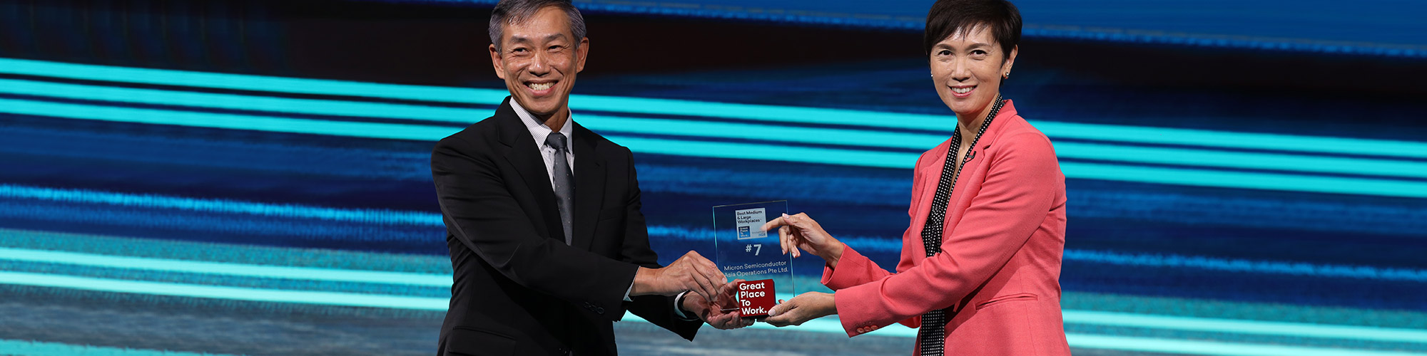 Chen Kok Sing, Frontend Manufacturing Corporate Vice President and Singapore Country Manager, on stage with Josephine Teo, Minister for Manpower, Singapore