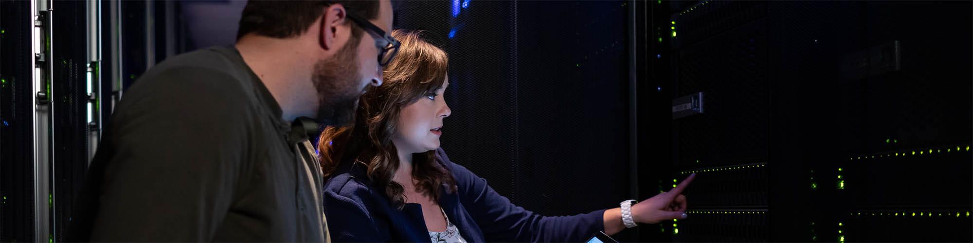Man and woman looking at servers