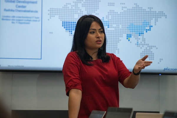 Woman giving a lecture in front of presentation