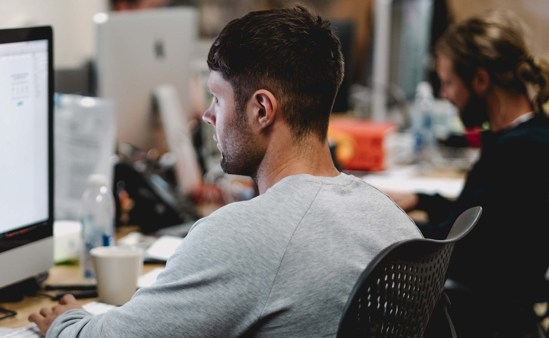 Man at desk working to stand out through relevant work experience to apply for Micron Careers