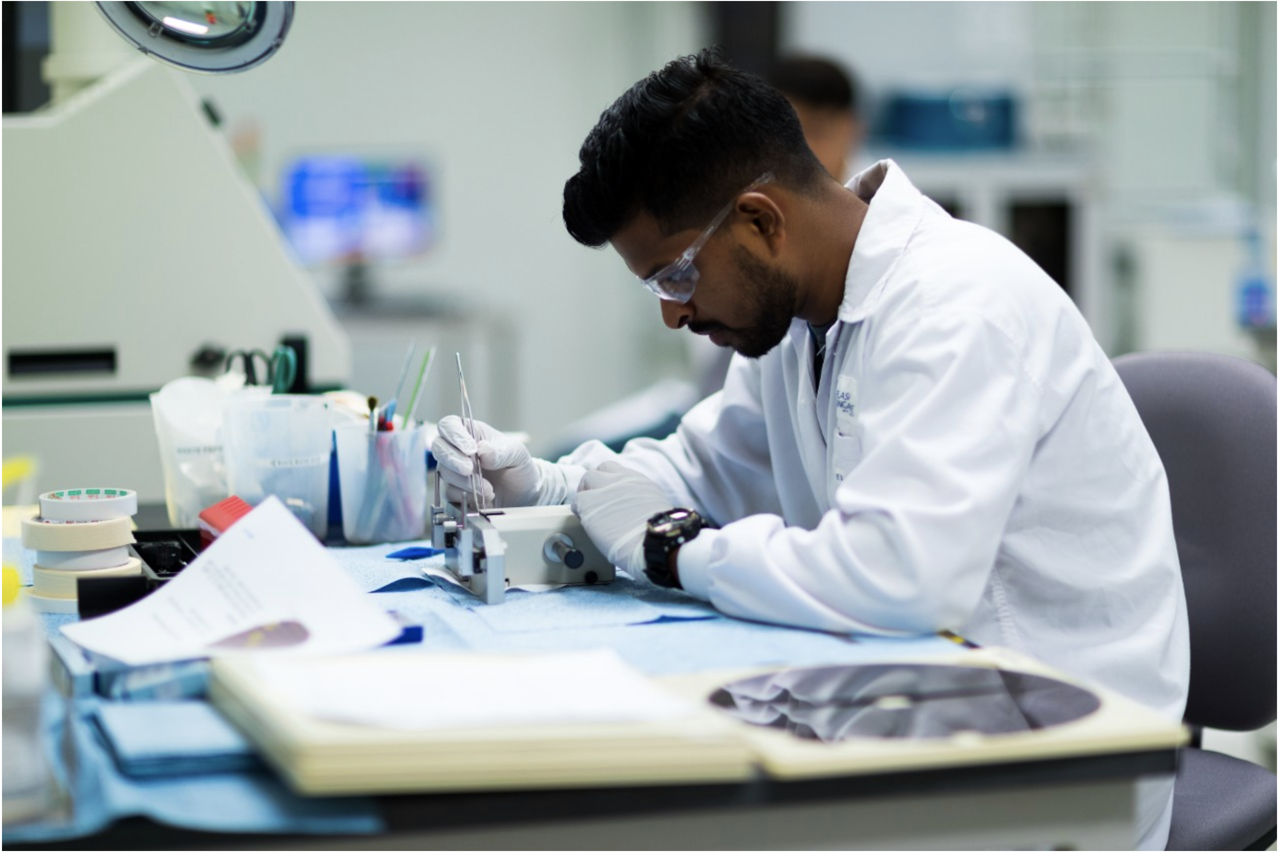 Image of male scientist working on a report in a lab